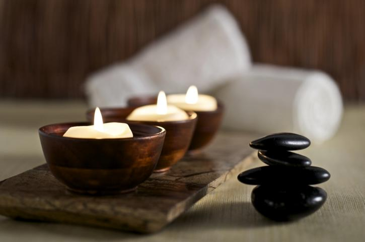 Candles and stones in a calm zen spa environment.